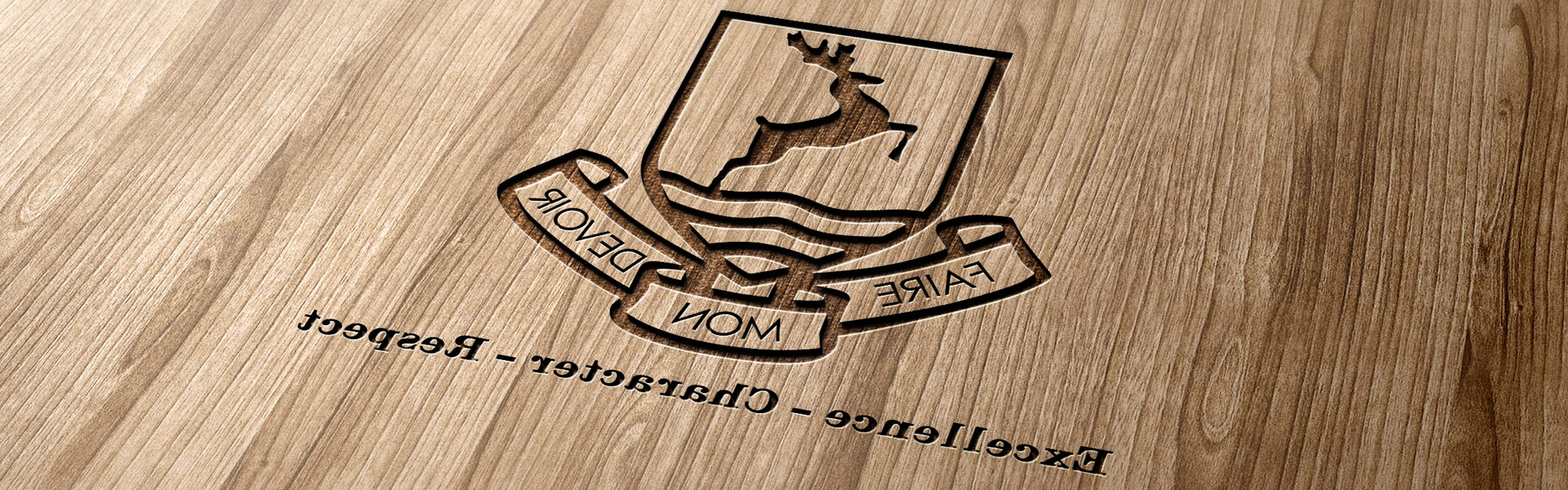 school logo and strapline laser-etched into wood
