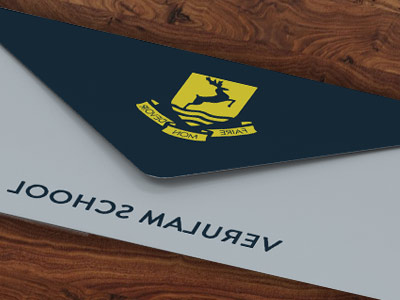 envelope in blue and white with yellow school logo on flap