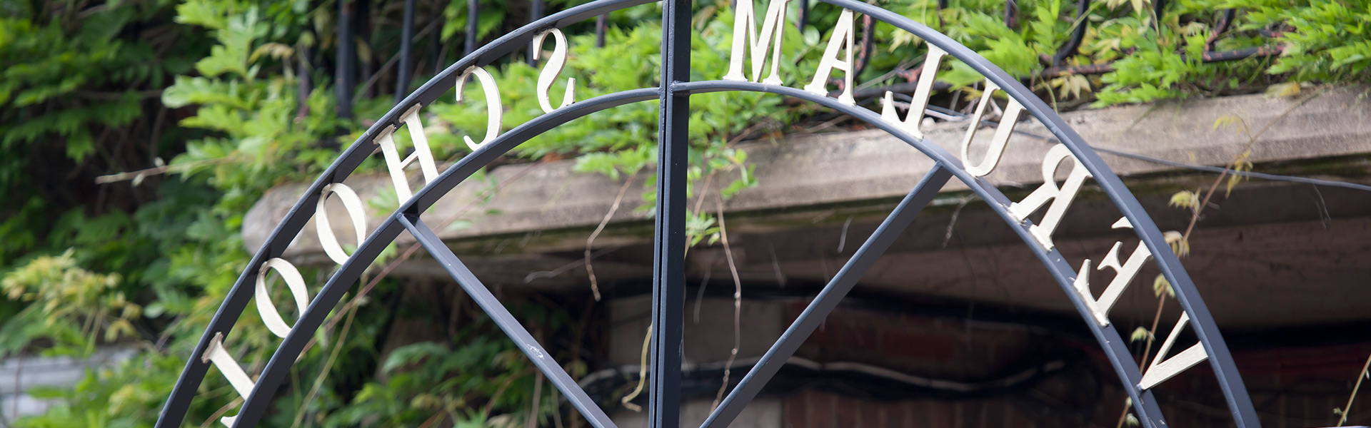the words 'verulam school' in wrought iron above school gates.
