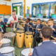 students play bongoes in music lesson